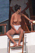 Catherine Zeta Jones sunbathing her topless from CelebMatrix