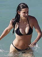 Courteney Cox huge breasts in a black bikini from CelebMatrix