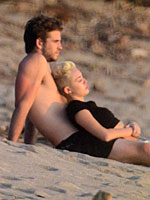 Miley Cyrus on a beach in costa rica