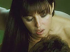 Monica Bellucci making out with a guy in doorway