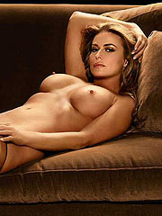 Carmen Electra showing tits and shaved pussy