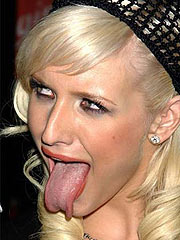 Ashlee Simpson large tongue and pose in bikini