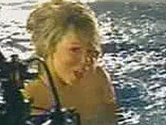 Mariah Carey nude against the edge of a pool