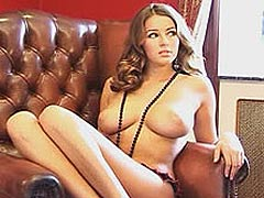 Keeley Hazell posing on a bed and shows big tits