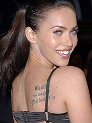 Megan Fox posing in sexy dresses and shows tattoo