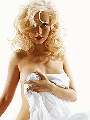 Christina Aguilera cover naked body with blanket