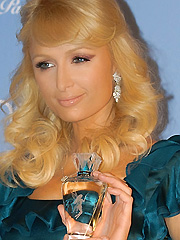 Paris Hilton fiddles with fairy dust