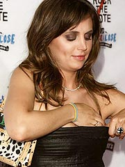 Eliza Dushku getting attention with her cleavage
