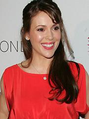 Alyssa Milano looks sexy in red dress