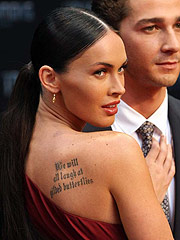 Megan Fox flaunting perky cleavage in sexy dress
