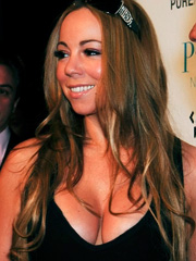 Mariah Carey exposing nasty cleavage
