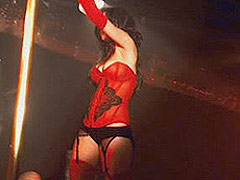 Lindsay Lohan in a red dress at a strip club