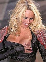 Pamela Anderson amazing nipple slip in public
