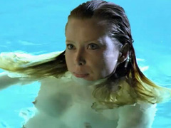 Emma Booth topless swimming in a pool