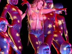 Carmen Electra dancing topless on stage