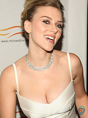 Scarlett Johansson showing nice cleavage in dress