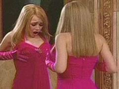 Ashley Olsen wearing pink dress and touching tits