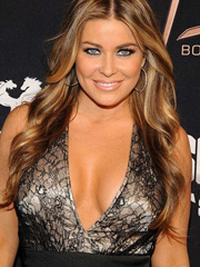 Carmen Electra cleavage comes out again