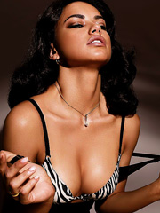 Adriana Lima cleavage spills out from bra