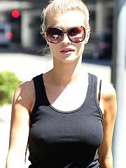 Joanna Krupa nipple pokies in black tank top