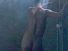 Demi Moore standing in a shower fully nude