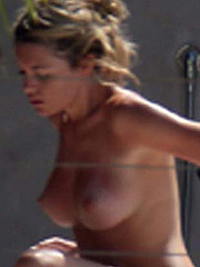 Abigail Clancy seductively sunbathing topless