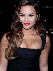 Demi Lovato bustsing out big cleavage
