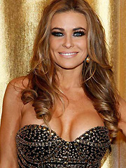 Carmen Electra busts her perfect cleavage