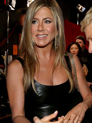 Jennifer Aniston oops pokies in leather dress