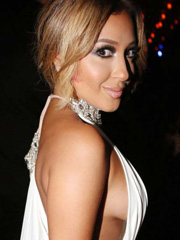 Adrienne Bailon shows some birthday sideboob