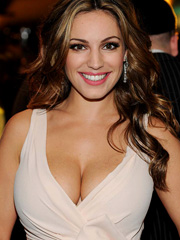 Kelly Brook busts out massive cleavage