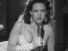 Carla Gugino busts hot cleavage while singing