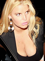 Jessica Simpson busts her massive cleavage