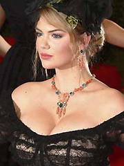 Kate Upton busts cleavage and flashes upskirt