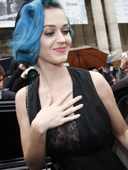 Katy Perry busts out see through cleavage
