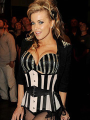 Carmen Electra wears sexy stripper costume