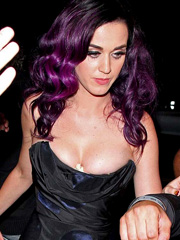 Katy Perry busts perky cleavage in hot dress