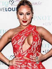 Adrienne Bailon big boobs pop out of dress
