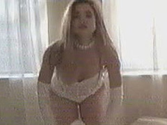 Denise Richards dancing in some white lingerie