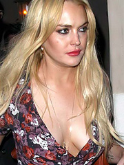 Lindsay Lohan breasts make a run for it