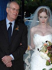 Christina Hendricks big cleavage in wedding dress