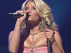 Jessica Simpson squeeze her breasts to the limit