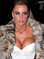Katie Price busting out big tanned boobs