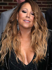 Mariah Carey busts out her huge cleavage