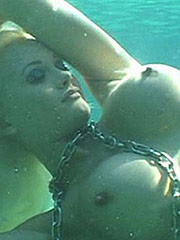 Holly Madison skimpy bikini and nice topless