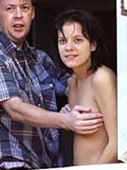 Lily Allen topless on a balcony in venice