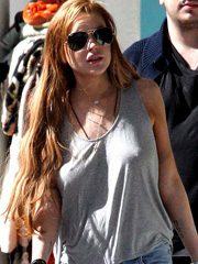 Lindsay Lohan caught braless in tank top