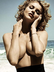 Eva Herzigova posing nude in magazine