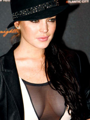 Lindsay Lohan flashes see through cleavage