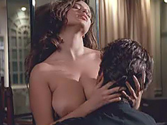 Debora Caprioglio large tits in hot sex act